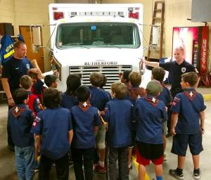 Cub Scouts listening attentively to first aid instruction